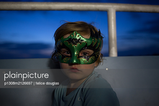 Kid with mask - p1308m2126697 by felice douglas