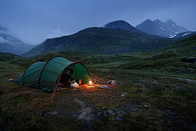 Norway, Tent by Jotunheimen range at dusk - p352m1349404 by Gustaf Emanuelsson