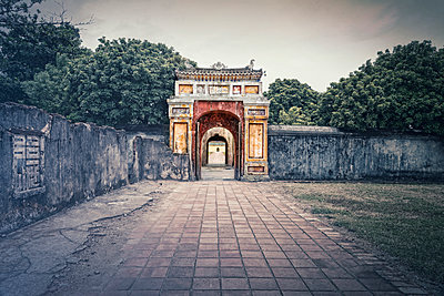 Archway and stonewall in Vietnam - p1445m2082662 by Eugenia Kyriakopoulou