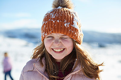 Teen girl in the snow  - p1612m2223697 by Heidi Coppock-Beard