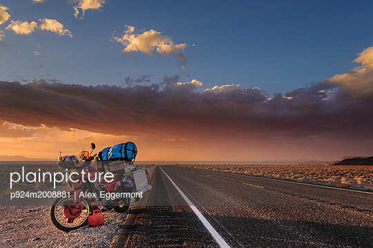 Motorcycle on roadside, getting away from a huge windstorm between Nevada and California, Bishop, California, United States