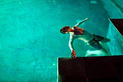 Swimming pool at night - p1307m1425758 by Agnès Deschamps