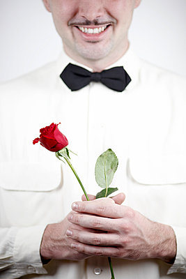 Man with roses - p611m984669 by Laurence Ladougne