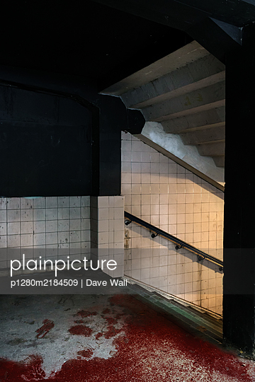 Subway station at night with floor covered in blood - p1280m2184509 by Dave Wall