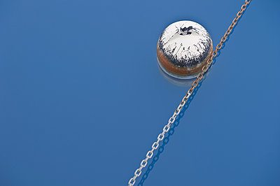 Buoy Floating on Water - p1100m2090818 by Mint Images