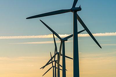 Wind turbine energy generators on wind farm - p1100m2271438 by Mint Images