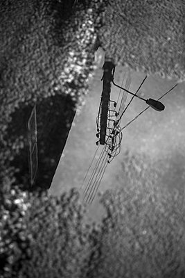 Reflection of an electric post - p1682m2264052 by Régine Heintz