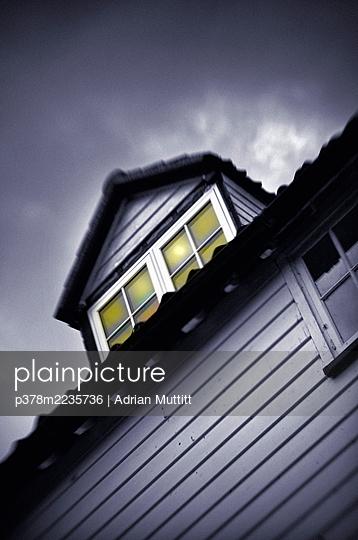 House under a cloudy sky - p378m2235736 by Adrian Muttitt
