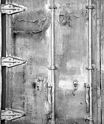 Close-up of door & hinges on packing container. - p1072m857597 by Joseph Shields