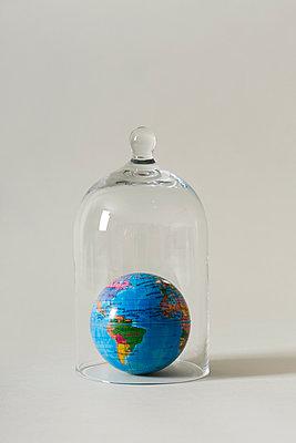 A world globe in a bell jar - p1423m2181448 by JUAN MOYANO