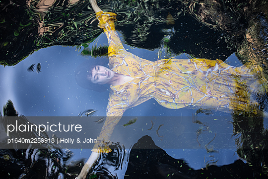 Woman in yellow dress in the lake - p1640m2259918 by Holly & John