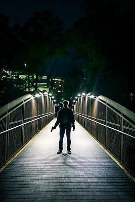 Man with Gun at Night  - p1019m1425276 by Stephen Carroll