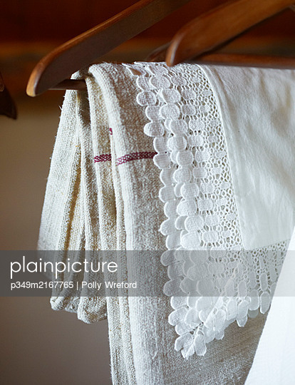 Lace and cotton fabrics hang in Sicilian home - p349m2167765 by Polly Wreford