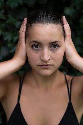 Young woman wearing black bikini top - p552m1445715 by Leander Hopf
