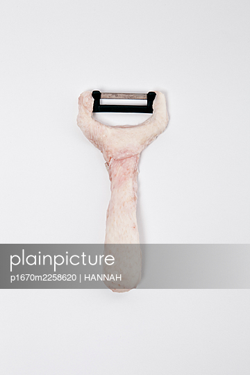 chicken skin on a peeler - p1670m2258620 by HANNAH