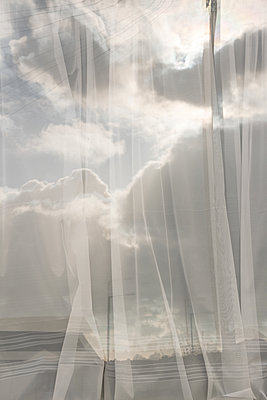 Curtain and clouds - p1327m2135171 by elenahelfrecht