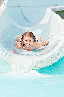 Front view of girl on water slide - p312m1551862 by Johner Images