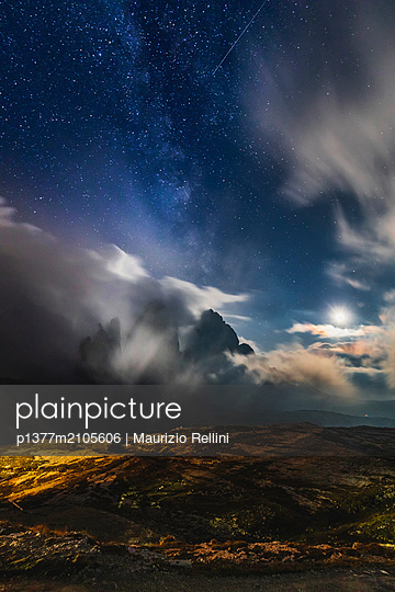 Italy, Trentino-Alto Adige, Bolzano district, Alps, Dolomites, Alta Pusteria, Dolomiti di Sesto Natural Park, Night view of Tre Cime di Lavaredo on a starry night - p1377m2105606 by Maurizio Rellini