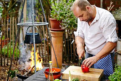 Man Cutting Fresh Bell Pepper - p1026m857178f by Dario Secen