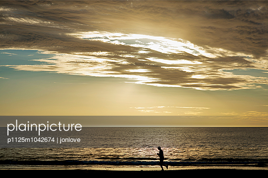 Afternoon beach runner  - p1125m1042674 by jonlove
