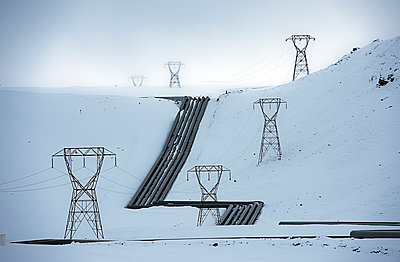 Power lines in snowy arctic landscape - p555m1415729 by Pete Saloutos