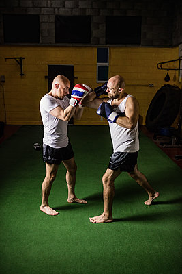 Two boxer practicing boxing in fitness studio - p1315m1198933 by Wavebreak