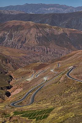 Serpentines and mountain ranges, Jujuy, Argentina - p1686m2288549 by Marius Gebhardt