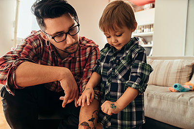 Proud son showing painted tattoo on his hand - p300m1204520 by Zeljko Dangubic