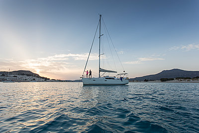 Sailing yacht at sunset - p948m1355273 by Sibylle Pietrek