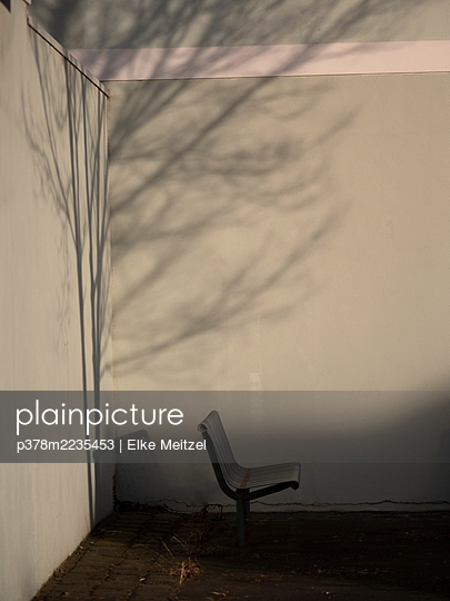 Shadow of tree and chair - p378m2235453 by Elke Meitzel