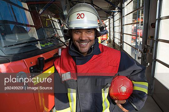 Fireman holding a football