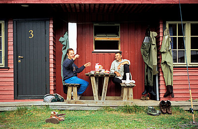 Norway, fishermen in front of fishing hut - p2680504 by Oliver Rüther