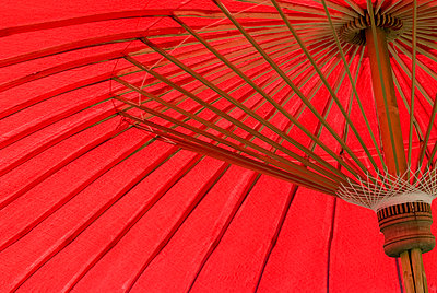 Red umbrella, Chiang Mai, Thailand, Southeast Asia, Asia - p8712759 by Rod Porteous