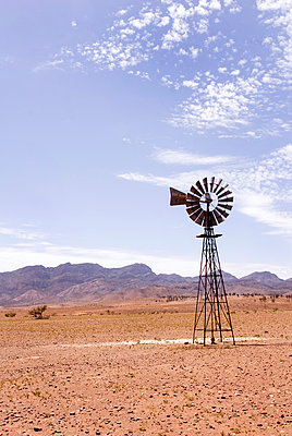 Windmill in the outback - p1072m905538 by Mia Mala McDonald
