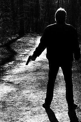 Man with a gun  - p450m2065259 by Hanka Steidle