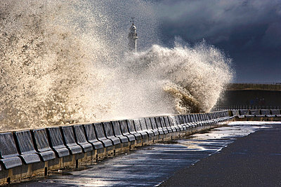Waves crushing against barrier, Sunderland, Tyne and Wear, England - p4426624f by Design Pics