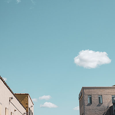 Residential buildings, clouds and blue sky - p758m2181756 by L. Ajtay