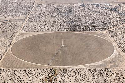 Brown crop circle Mojave Desert - p1048m1069306 by Mark Wagner