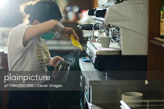 Hands of young adult caucasian female barista at work preparing - p1166m2201350 by Cavan Images