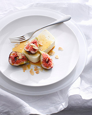 Goat cheese with figs and almonds - p42919125 by Brett Stevens
