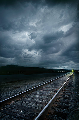 Train on railroad tracks at stormy day - p1427m2200867 by Chris Clor