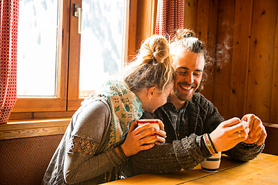 Couple in a mountain cabin - p1142m1035026 by Runar Lind