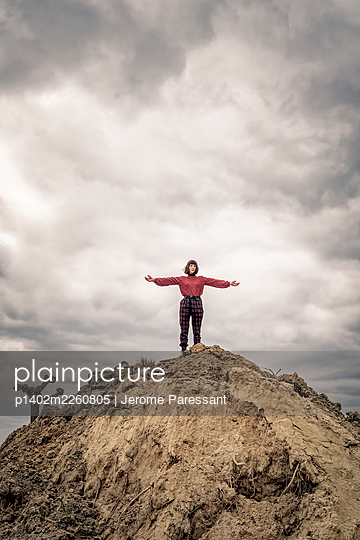Girl on soil mound - p1402m2260805 by Jerome Paressant