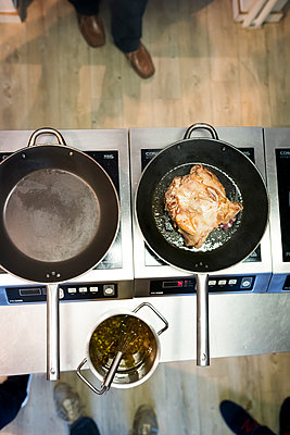 Pans on the stove - p1076m1492819 by TOBSN