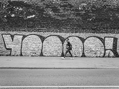 Young man walking on the street - p1267m2090171 by Wolf Meier