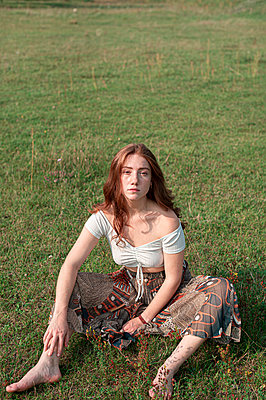 Young woman on a meadow - p1609m2254082 by Katrin Wolfmeier