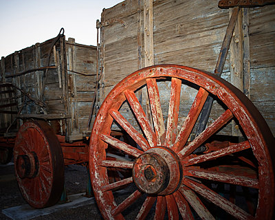 Red wagon wheel, Harmony Borax Works. Death Valley National Park, California. - p343m1554634 by Ron Koeberer