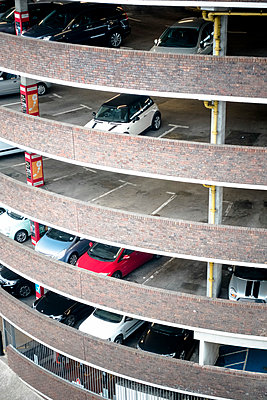 Cars parked in round city centre multi-storey car park - p1302m1445267 by Richard Nixon