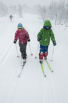 Two people snowshoeing in forest - p312m1229158 by Fredrik Schlyter