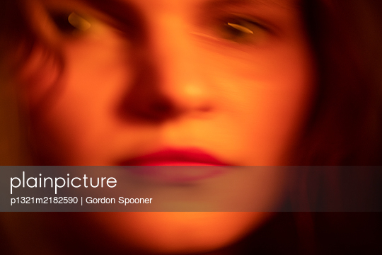 Blurred face of a woman - p1321m2182590 by Gordon Spooner